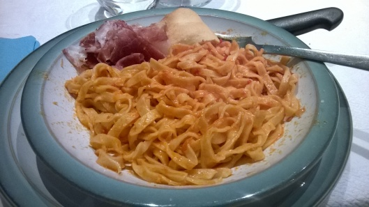 Homemade Italian pasta from my friend! Simple pasta, cheese and tomato sauce. :)